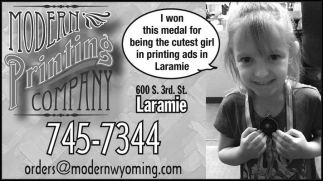 I won this medal for being the cutest girl in printing ads in Laramie